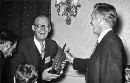 Arthur C. Clarke receives Hugo Award from chairman Dave Kyle at the 1956 Worldcon, NyCon II.