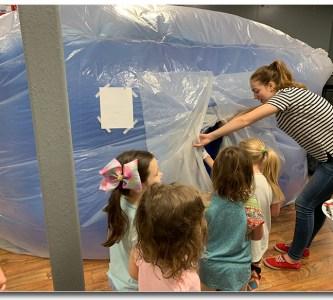 Preschool students entering the biome.
