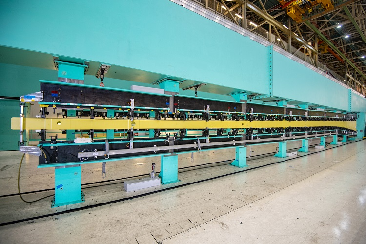 An 82.4-foot long 767 wing spar is loaded into a tool in Boeing's Everett, Wash., factory, kicking off assembly of the first KC-46A tanker for Japan. Boeing is currently on contract to build two of the multi-role tankers for the Japan Air Self-Defense Force. (Boeing photo)