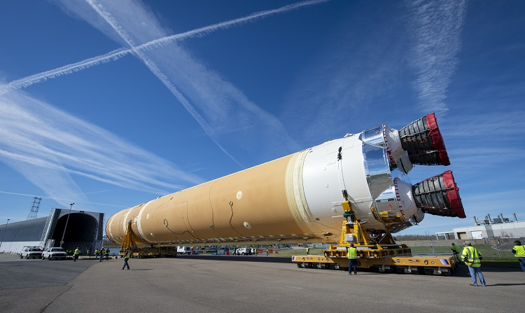 The Boeing-built core stage of NASA's first Space Launch System (SLS) deep space exploration rocket arrives at the agency's Pegasus barge on Jan. 8 after rolling out of the NASA Michoud Assembly Facility in New Orleans. (Boeing photo)