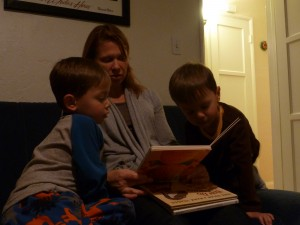 Dawn and boys sit down to read a book