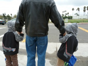 Eloy and Twin boys walking to school