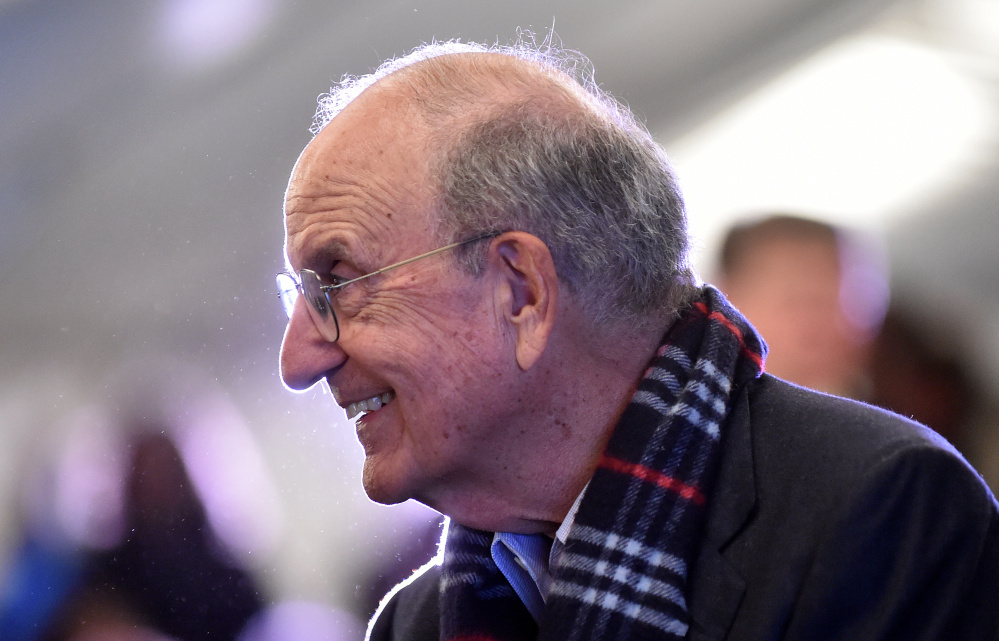 Former U.S. Sen. George Mitchell speaks with people Tuesday during the Harvest on the Square on Common Street in downtown Waterville.