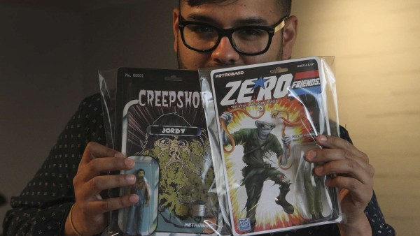 Retroband (Aaron Moreno) with two of his action figure creations