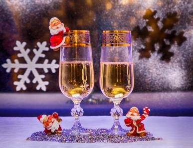 glasses of champagne Christmas trees Christmas toys gnome on the background of the winter window. holiday photo in old style of the image. colored lights stylized graphics holiday card wallpaper
