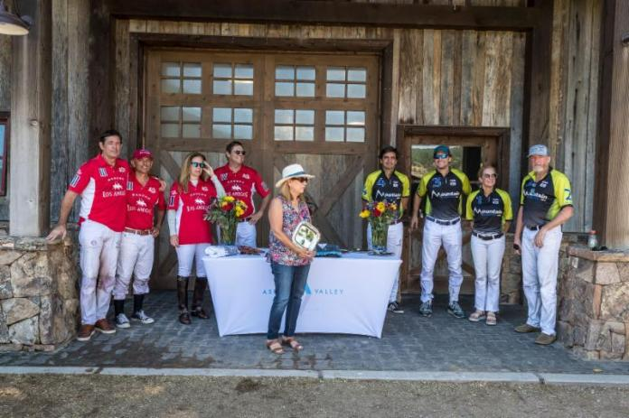 Museum of Polo and Hall of Fame curator Brenda Lynn Dupont presents awards after the game.