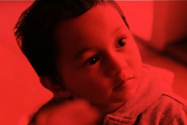 boy looking up red