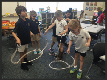 First-graders learning to spin ropes.