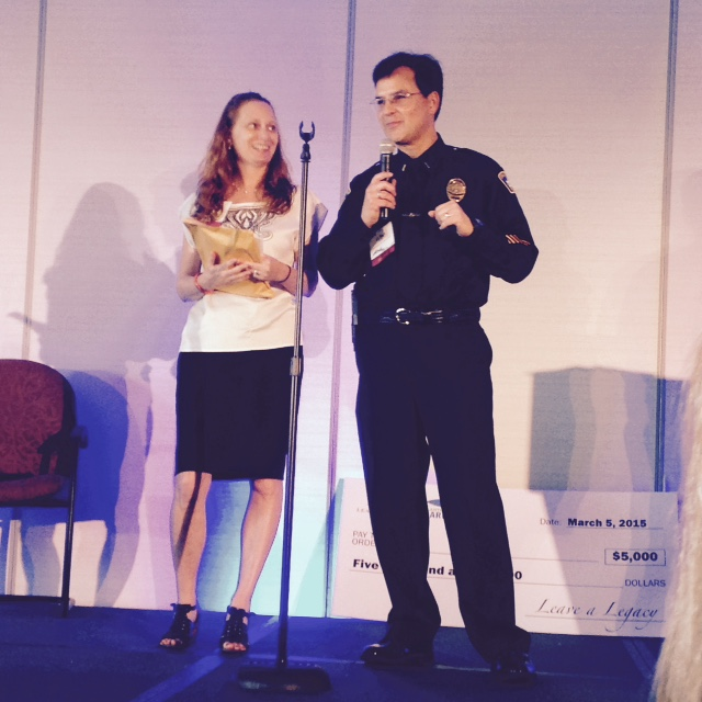 Debbie Dietz and Lt. Bart Barta giving a presentation at the Leave a Legacy, Philanthropy Miami Event.