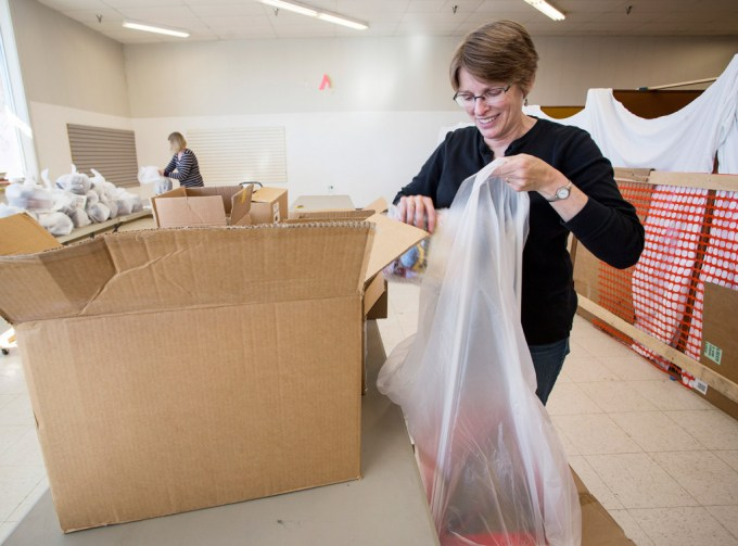 Cathy Houlihan of Cape Elizabeth organizes toys that will be given to needy Maine children.