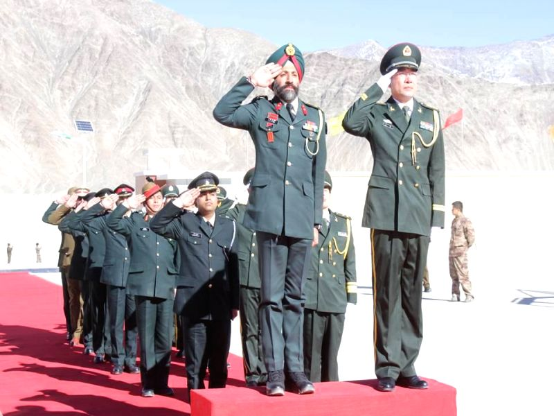 Photos :: Chushul: Indian Army personnel meet PLA personnel during a ...