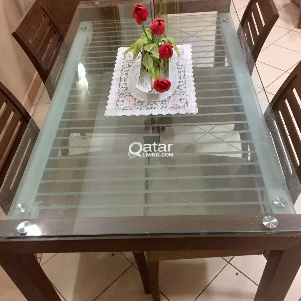 there a table and four chairs in my living room decorative wall mirrors dining with good condition qatar title information