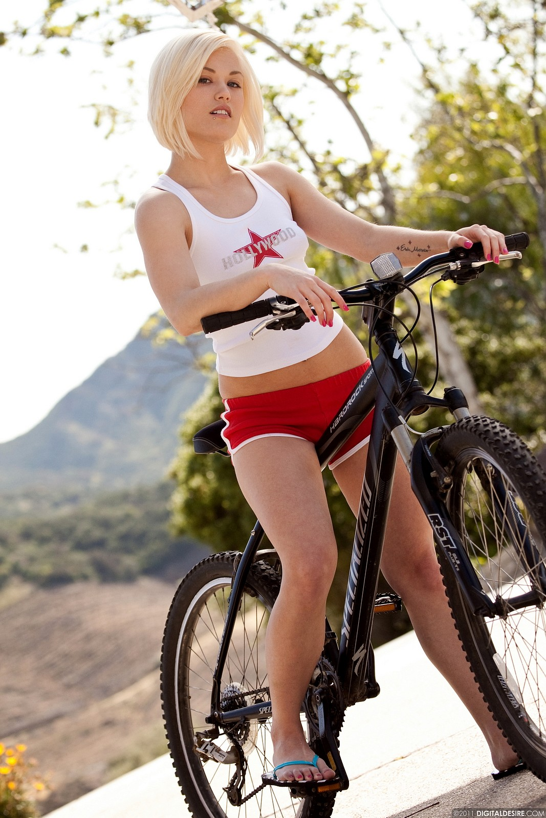 Ash Hollywood, blonde, strip, bicycle, shorts