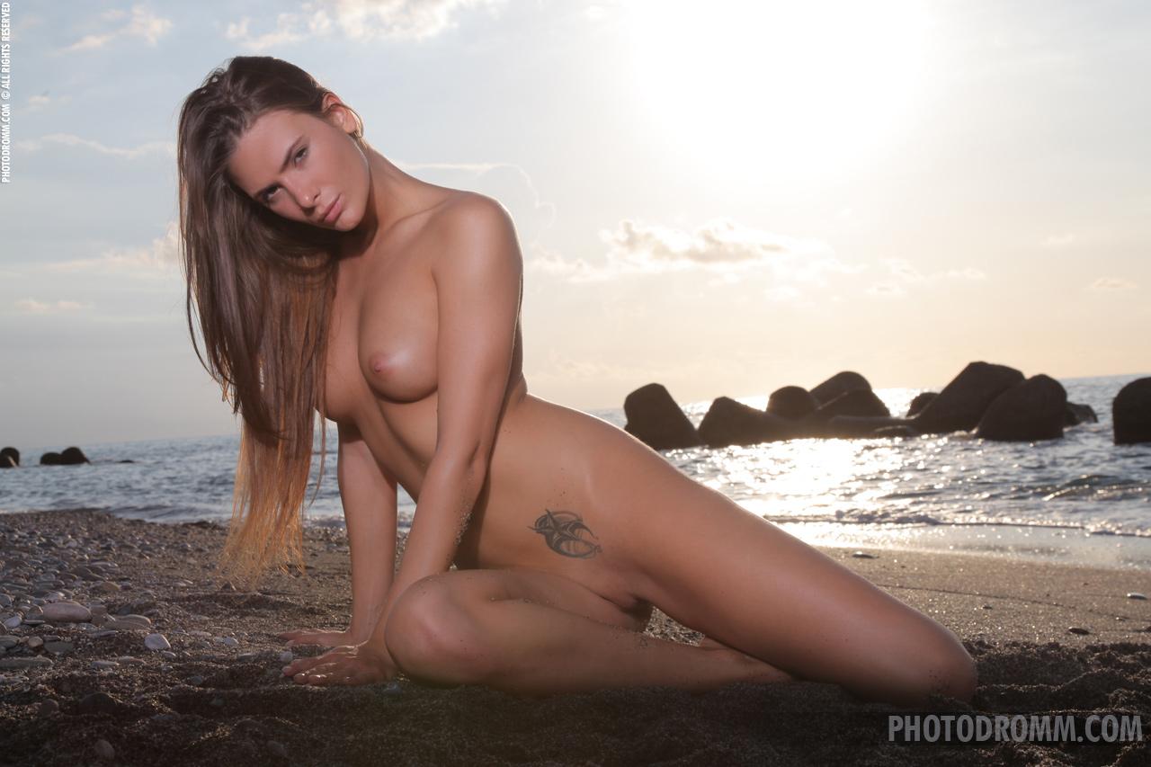 Juliette, brunette, nude, perky, ass, beach, sand, pose