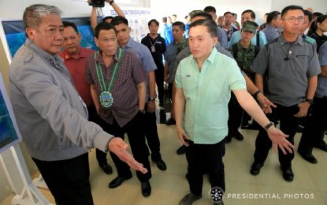 Duterte-is-accompanied-by-Transportation-SAP-Christopher-Lawrence-Go-after-the-President-was-given-a-briefing-on-the-operational-condition-and-the-upgraded-facilities-of-Lal-lo-Ai