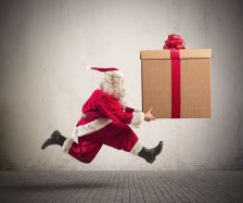 Fast runner Santa Claus with a big present
