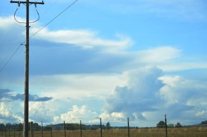 090415 blue sky clouds field
