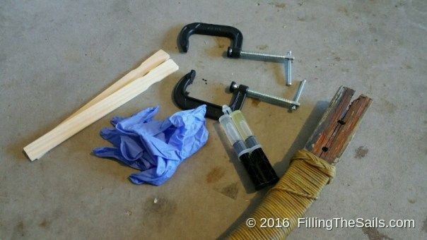 I gathered my clamps, gloves, epoxy and went to work.