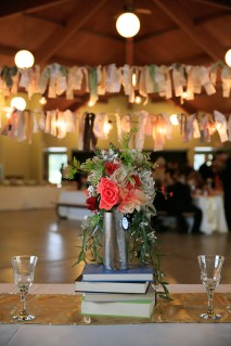 Bridal bouquet/Head table centerpiece with DIY banner in background