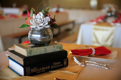 Vintage books and handmade flowers for centerpieces