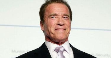 Arnold Schwarzenegger Smiling Black Suit White Tie