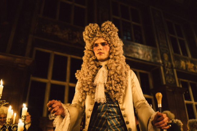 "Nicholas Hoult wears an enormous wig in ""The Favourite"". Photo: © 2018 Twentieth Century Fox"