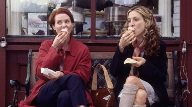 Better than sex? Miranda and Carrie enjoying their cupcakes in front of the Magnolia bakery. Photo: HBO