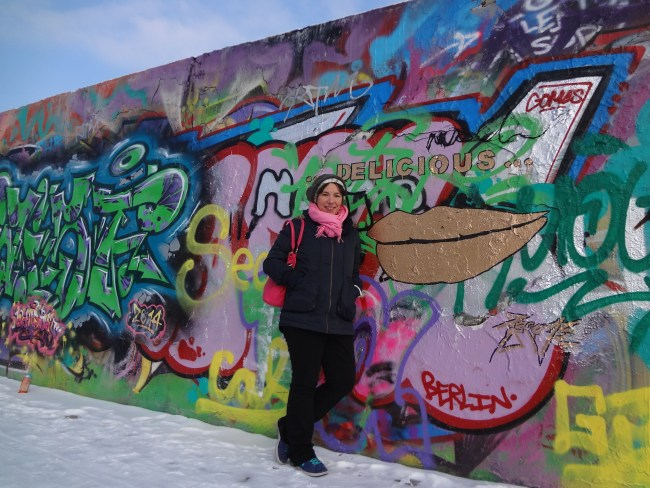 Me at the Berlin Wall on 10 Budget-Friendly Things to Do in Berlin © Sonja Irani / FilmFanTravel.com