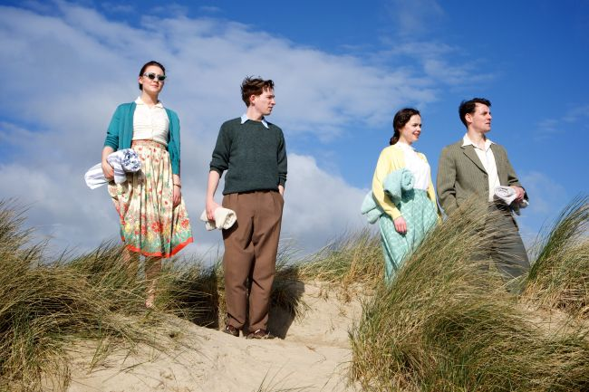 "Enjoying the view at an Irish beach. Scene from the film ""Brooklyn"". Photo: © 2015 Twentieth Century Fox"