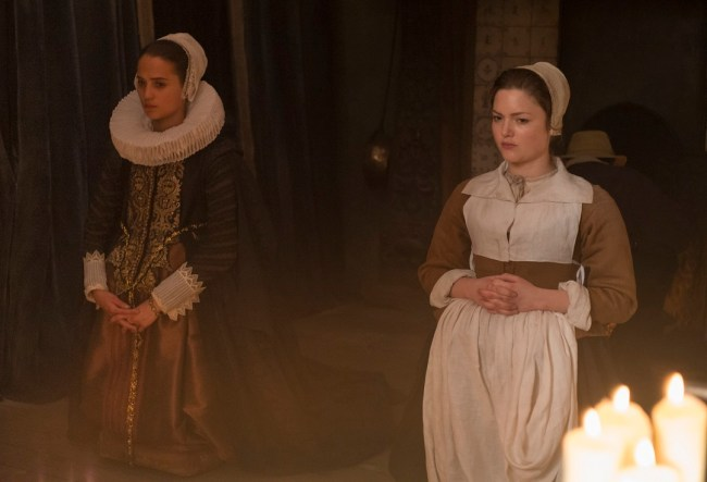 "Alicia Vikander and Holliday Grainger in ""Tulip Fever"". Photo: Alex Bailey © 2014 The Weinstein Company."