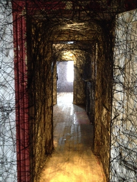 Chiharu Shiota, Trace of Memory, 2013, yarn, desk, sewing machine, suitcases, wedding dress, bed, books, chairs (all photos by author)