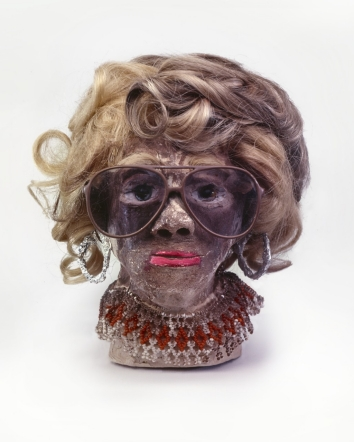"""James 'Son Ford' Thomas, Untitled, 1987, 11.5"""" height Unfired clay, artificial hair, sunglasses, wire, aluminum foil, beads, glass marbles, paint Courtesy of William S. Arnett Collection of the Souls Grown Deep Foundation"""