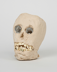 """James 'Son Ford' Thomas, Untitled, Date unknown, 7.5 x 5.5 x 4.5"""" Unfired clay, aluminum foil, human teeth Photograph by Marie Catalano Courtesy of Thomas E. Scanlin Collection"""