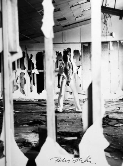 Peter Berlin, Self Portrait in White Jumpsuit on the Piers New York City, c. 1970s, Vintage gelatin silver print