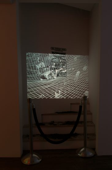 Hilton Als, Dirt Nap/Disco Nap, 2016, dimensions variable, slide projector, black velvet rope with stanchions, GG's Barnum Room poster; Projected slide: Bill Bernstein, GG's Barnum Room, Disco Bats on Net, 1979, dimensions variable, 35mm slide transfer.