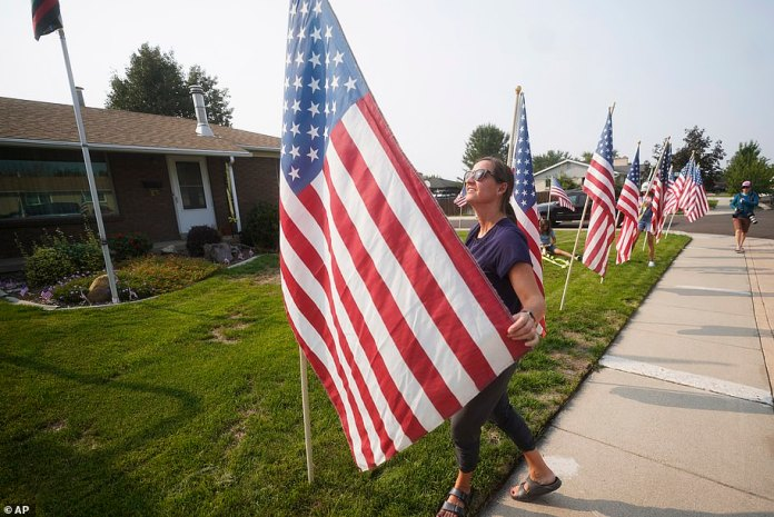 Neighbor Lena McIllece helped arranged the flags to honor Hoover and the other fallen troops