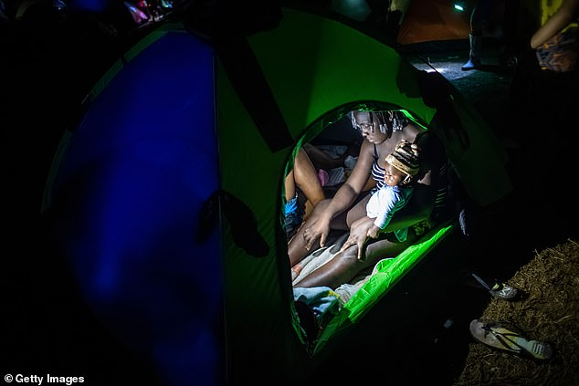 Migrants from Haiti spend a night at a base camp on October 6 before trekking through the infamous Darien Gap to try and claim asylum in the US