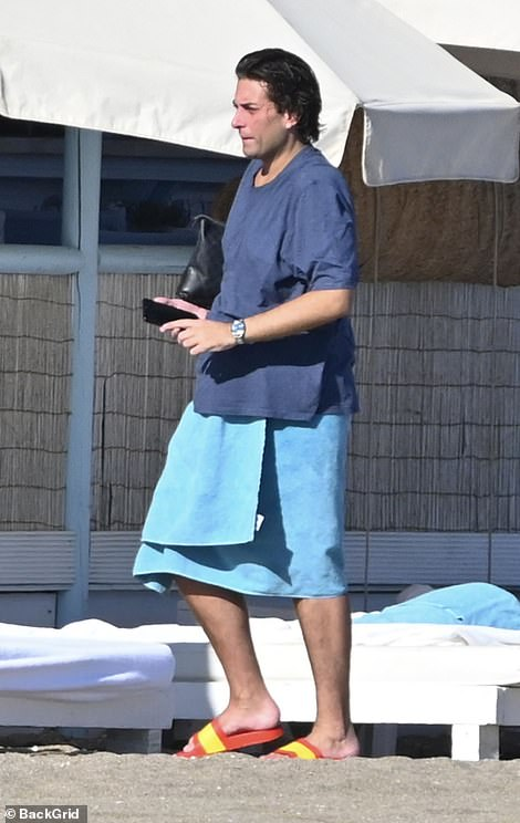 Summer: He then changed into a blue T-shirt and wrapping a light blue towel around his waist