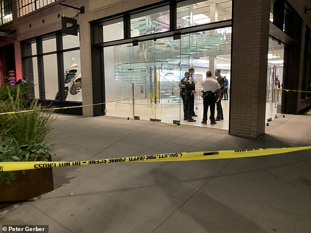 Police tape goes up in front of the West 14th Street Apple Store following the Friday night stabbing