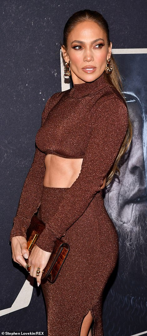 Stunner: The Hustlers star stayed on point with a brown alligator print clutch with a gold clasp