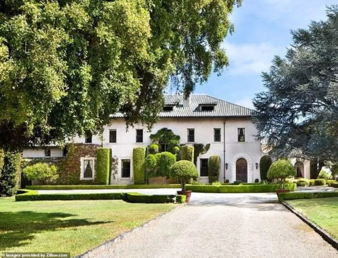 Elon Musk has slashed the price of his Bay Area mansion (pictured) located at891 Crystal Springs Rd in Hillsborough, California, by $5.5million to $31.99million as he struggles to sell the last of his remaining properties after vowing to 'rid himself of all possessions'