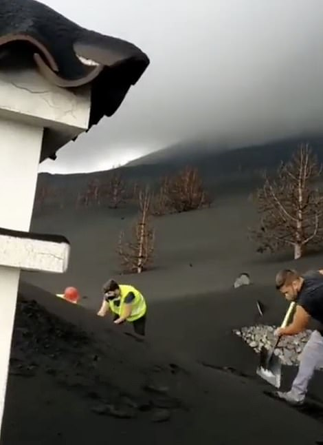 Footage filmed by local Juanma Hernandez shows homes barely visible under a mountain of black ash