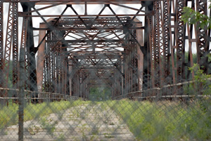 Whether to restore or replace the officially unusable Old Cedar Avenue  Bridge.