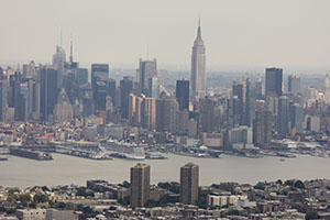 Securities linked to skyscrapers, shopping malls, hotels and apartment buildings have gained 0.43 percent this month.  An aerial view shows the Manhattan, New York, skyline in the background over Weehawken, N.J. (Bloomberg News: Scott Eells)