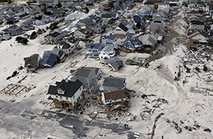 A view from the air on Oct. 31, 2012, shows the destroyed homes left in the wake of Superstorm Sandy in Seaside Heights, N.J. (AP file photo: Mike Groll)