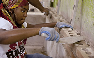 Raven Jones, 21, works on a brick wall at the Trade Institute of Pittsburgh.  Highly skilled construction workers are aging, and there may be a shortage of younger Americans with the training needed to replace them. (Bloomberg photo: Kevin Lorenzi)