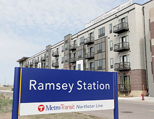 Flaherty and Collins Properties held a grand opening of The Residence at the COR in Ramsey Thursday. The building has a direct connection to the Northstar Commuter Rail line, which is also spurring development in other nearby cities. (Staff photo: Bill Klotz)