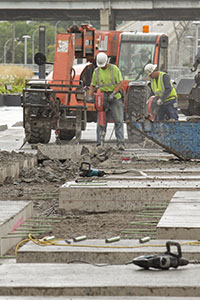 Construction workers jackhammer portions of one of the concrete bus platforms at Union Depot, 214 Fourth St. E., in St. Paul Friday. The platforms have been closed since cracks were detected. (Photo: Matt M. Johnson)