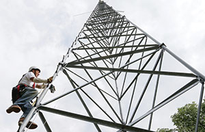 Charles Grell checks the bolts on an 80-foot tower at a rural residence near Webster, Minn. (Staff photo: Bill Klotz)
