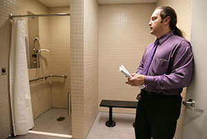 Jose Weeks, a facilities manager for the ABC Parking ramps in downtown Minneapolis, shows one of the shower facilities available to bike commuters at the B ramp at 515 Second Ave. N. (Staff photo: Bill Klotz)
